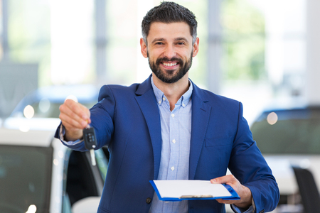 drivers license: Car dealer in showroom