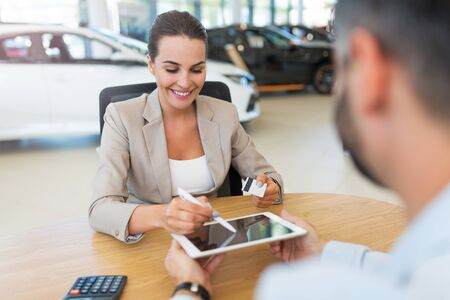 Woman buying a new car Stock Photo