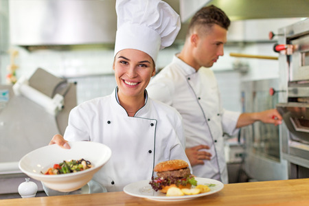 Two smiling chefs in kitchen Banque d'images
