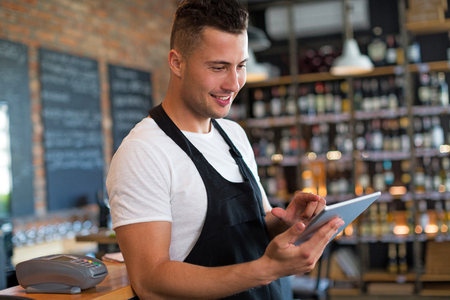Man working at cafe Stock Photo