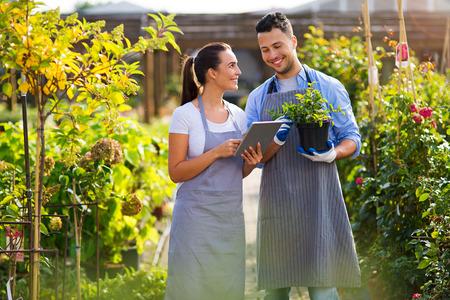 Smiling employees in garden center
