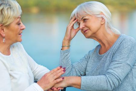 Senior Woman Consoling Her Friend 版權商用圖片 - 90420051