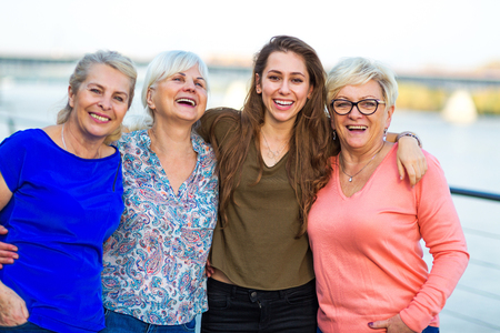Group of women smiling outdoors Stock Photo