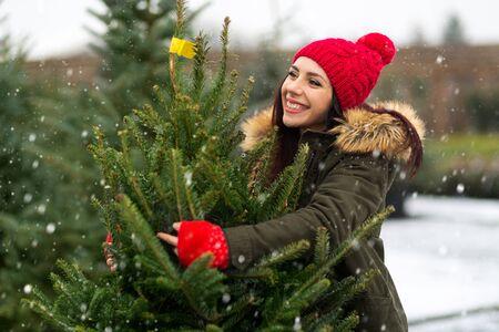 Woman buying Christmas tree