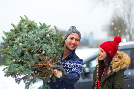 Young couple picking the Christmas tree