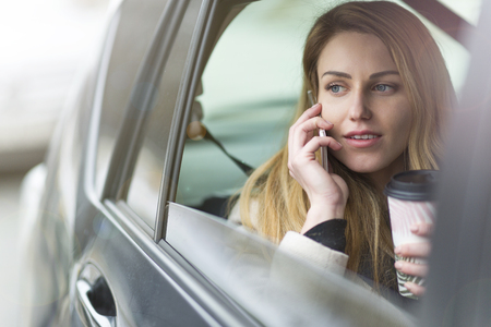 Young woman sitting in a taxi