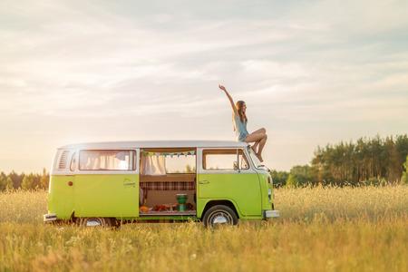 Young woman enjoying a roadtrip