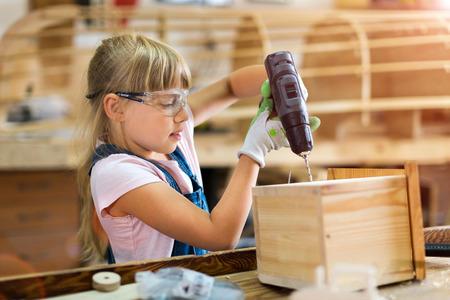 Kids working at workshop