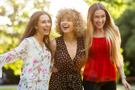 Group Of Three Female Friends Having Fun Together Imagens