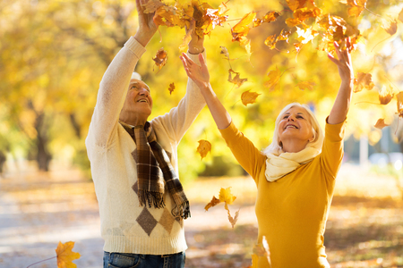 Elderly couple together in autumn park
