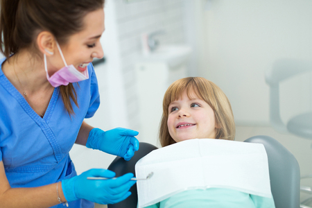 Young girl have a checkup at the dentist