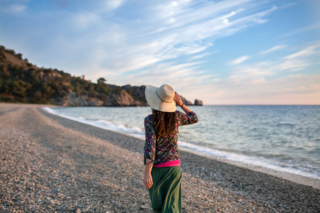 Young woman walking on the beach, Cala del Ca?uelo, Andalusia, Spain