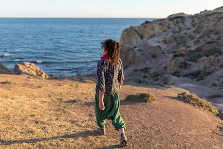 Woman exploring Spanish coastline, Cabo de Gata - Nijar Natural Park, Spain