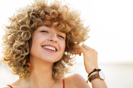 Portrait of young woman with curly hair Stock fotó