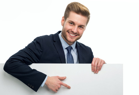 Business man holding white board