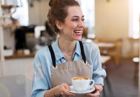 Woman working in coffee shop 免版税图像
