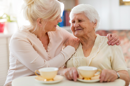 Senior woman spending quality time with her daughter
