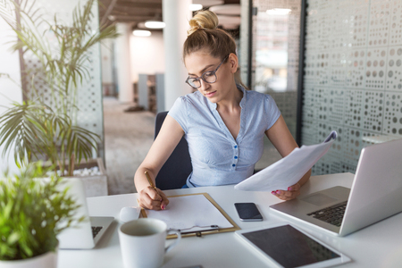 Young business woman working at desk