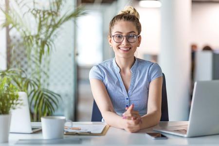 Portrait of confident creative businesswoman in office