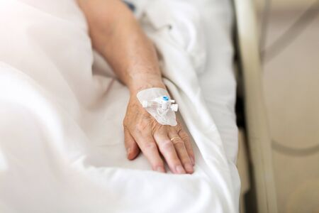Cropped Image Of Patient With Iv Drip At Hospital