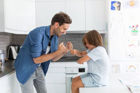 Father and son in kitchen Banco de Imagens