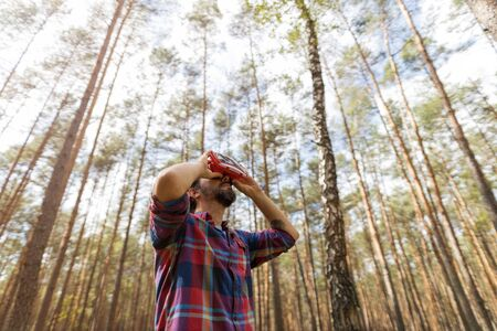 Man Wearing Virtual Reality Simulator While Standing In The Forest Stock Photo