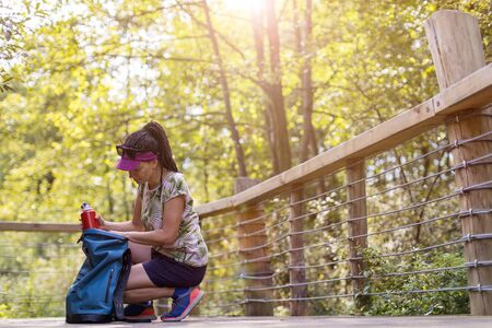 Young woman hiking in the forest Stock Photo