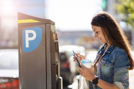Young Woman Using Parking Machine Stockfoto