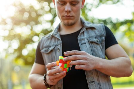Man playing a cube game