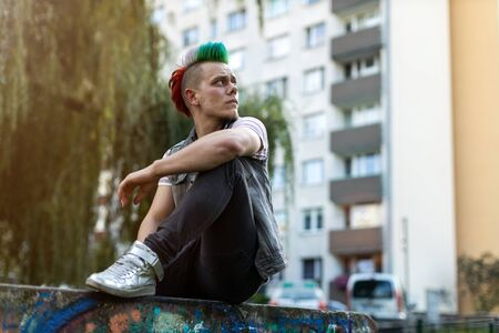 Portrait of a cool young man with colorful mohawk hair