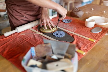Woman pottery artist makes ceramics from clay