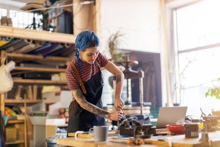 Craftswoman working in her workshop