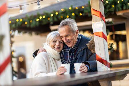 Happy senior couple having fun on the Christmas Market