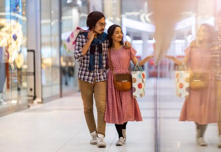 Happy young couple in shopping mall Stock Photo