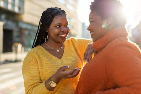 Two beautiful Afro american women having fun together in the city Stock Photo