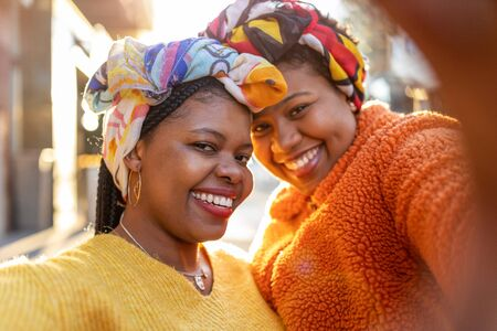 Beautiful happy girlfriends taking a selfie together Stock Photo