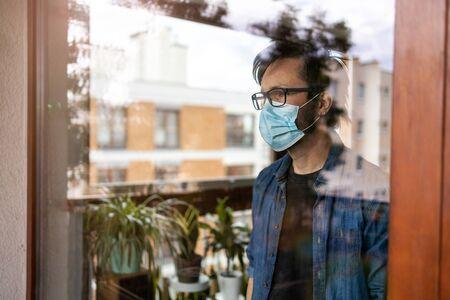 Man in isolation at home for virus outbreak Banco de Imagens