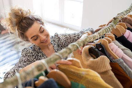 Young woman choosing clothes
