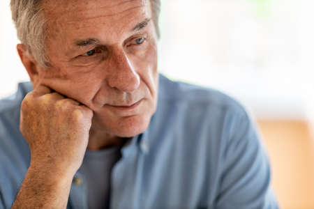 Portrait of senior man looking depressed