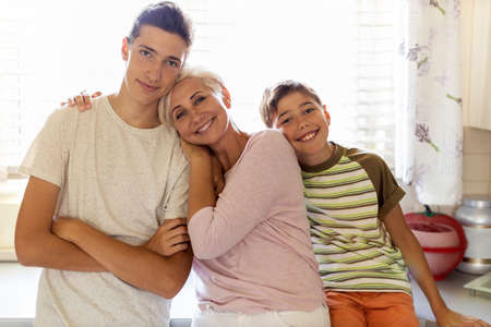 Happy mother with her two sons Imagens