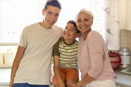 Happy mother with her two sons Stock Photo