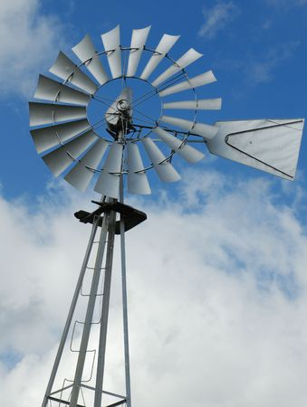 farm windmill water pump against blue sky with clouds Stock Photo - 2816739