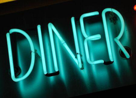 illuminated blue neon sign at night - diner Stock Photo