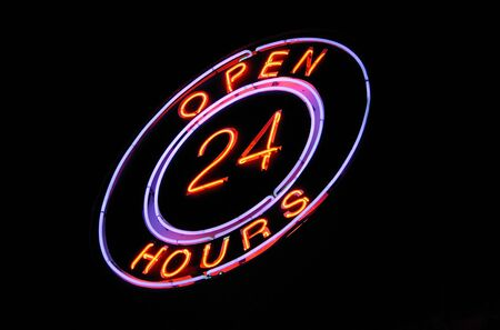 beverage display: pink & blue neon Open 24 hours sign at night   Stock Photo