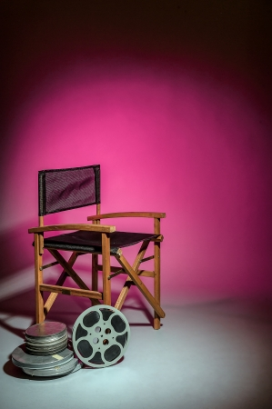 Director's cut concept of movie director chair with 16mm film spools photo