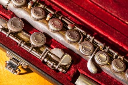 tarnished: Tarnished old brass flute in velvet case, close-up of keys Stock Photo