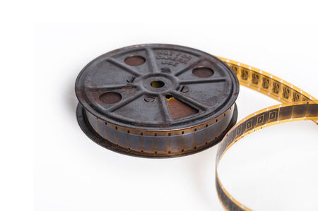 Vintage sepia 16mm film with reel - movie concept with space for text