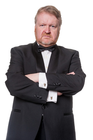 Tough man in tuxedo with arms crossed photo