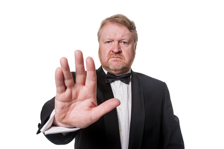 Bouncer holds out hand to signal to halt Stock Photo