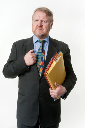 cynical: Stern businessman with folders under his arm Stock Photo
